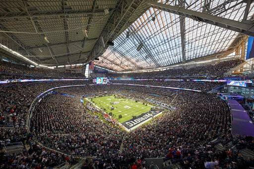 FILE - This Feb. 4, 2018, file photo shows U.S. Bank Stadium during the pregame of the NFL Super Bowl 52 football game, in Minneapolis. Build it and the Super Bowl will come. While that's not exactly how the sites of the NFL's championship extravaganza are determined, it sure doesn't hurt to have a brand new, billion-dollar facility in your city.
