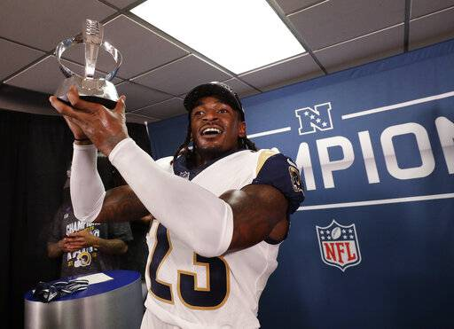 Los Angeles Rams defensive back Nickell Robey-Coleman celebrates with he NFC trophy after overtime of the NFL football NFC championship game against the New Orleans Saints, Sunday, Jan. 20, 2019, in New Orleans. The Rams won 26-23.