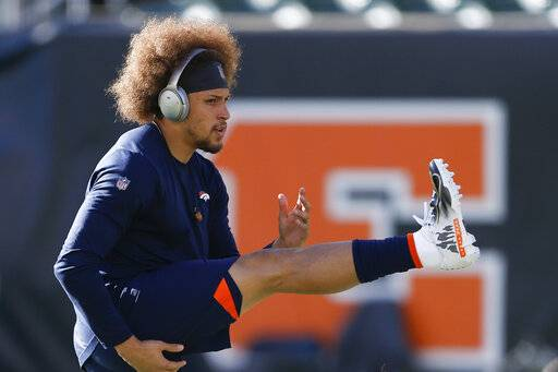 FILE - In this Dec. 2, 2018, file photo, Denver Broncos running back Phillip Lindsay practices before an NFL football game against the Cincinnati Bengals, in Cincinnati. He didn't get invited to the NFL combine and wasn't selected in the NFL draft. Then, an injury threatened to keep Phillip Lindsay from the spoils of his sensational season, the Pro Bowl. Although he won't be playing, the Denver Broncos rookie running back is attending the league's annual all-star game as a social media correspondent for the league.