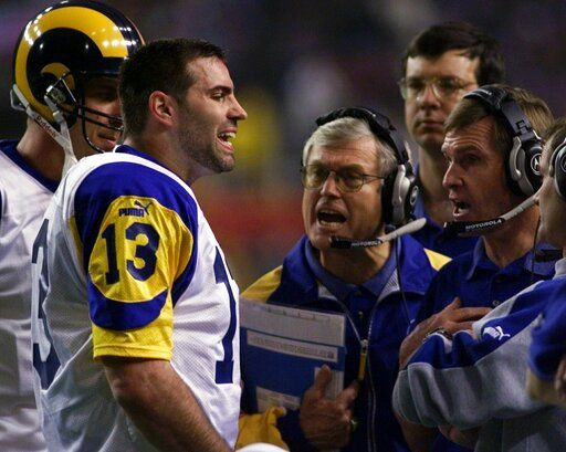 File-This Jan. 30, 2000, file photo shows St. Louis Rams quarterback Kurt Warner talking to Rams head coach Dick Vermeil, at center, and other coaches during a St. Louis Rams timeout in the second quarter in Super Bowl XXXIV in Atlanta. The Greatest Show On Turf. Yes, at the turn of the century, there was a group that shared so many light-em-up traits with these Rams and Patriots. The St. Louis Rams under of all people,  Vermeil, for decades a defense-minded coach,  employed a quick-strike scheme with a resourceful quarterback, game-breaking receivers, a Hall of Fame running back  and an offensive line that could dominate while blocking in the ground game or protecting the passer.