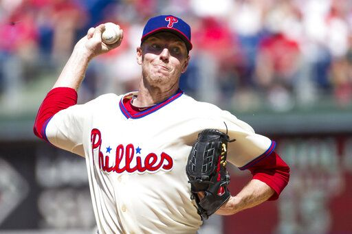 File-This Aug. 25, 2013, file photo shows Philadelphia Phillies starting pitcher Roy Halladay throwing a pitch during the third inning of a baseball game in Philadelphia. Halladay, an ace with the Toronto Blue Jays and Philadelphia Phillies, got 85.4 percent and will be the first posthumous inductee since Deacon White in 2013 and Ron Santo in 2012. Halladay died in November 2017 at 40 years old when an airplane he was flying crashed into the Gulf of Mexico off the coast of Florida.