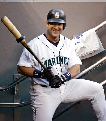 FILE - In this Oct. 2, 2004, file photo, Seattle Mariners designated hitter Edgar Martinez waits his turn to bat against the Texas Rangers, Saturday, Oct. 2, 2004, in Seattle. Martinez was elected to baseball's Hall of Fame Tuesday, Jan. 22, 2019.