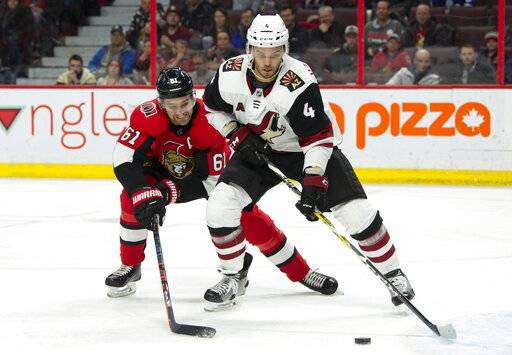 Ottawa Senators right wing Mark Stone (61) battles with Arizona Coyotes defenseman Niklas Hjalmarsson during the second period of an NHL hockey game in Ottawa, Tuesday, Jan. 22, 2019. (Adrian Wyld/The Canadian Press via AP)