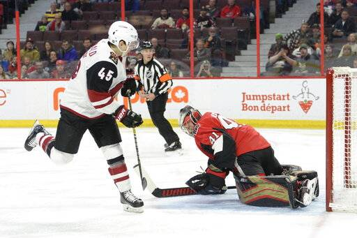 Ottawa Senators goalie Craig Anderson (41) makes a save on Arizona Coyotes' Josh Archibald during first period NHL action in Ottawa, Tuesday, Jan. 22, 2019.  (Adrian Wyld/The Canadian Press via AP)