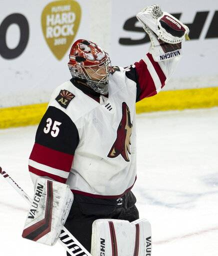 Arizona Coyotes goaltender Darcy Kuemper celebrates at the end of third period NHL action against the Ottawa Senators, in Ottawa, Tuesday, Jan. 22, 2019. Kuemper made 25 saves as the Coyotes defeated the Senators 3-2. (Adrian Wyld/The Canadian Press via AP)