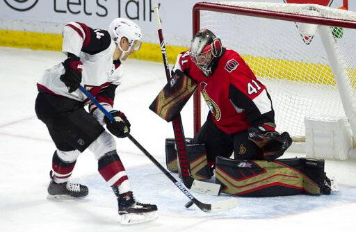 Arizona Coyotes right wing Richard Panik (14) fails to score on Ottawa Senators goaltender Craig Anderson during third period NHL action in Ottawa, Tuesday, Jan. 22, 2019. (Adrian Wyld/The Canadian Press via AP)