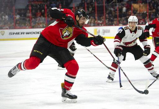 Arizona Coyotes centre Clayton Keller (9) looks on as Ottawa Senators left wing Nick Paul breaks his stick taking a shot during the second period of an NHL hockey game in Ottawa, Tuesday, Jan. 22, 2019. (Adrian Wyld/The Canadian Press via AP)