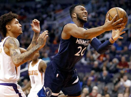 Minnesota Timberwolves guard Josh Okogie (20) drives to the basket as Phoenix Suns forward Kelly Oubre Jr. defends during the first half of an NBA basketball game, Tuesday, Jan. 22, 2019, in Phoenix.
