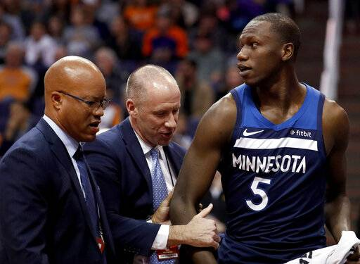 Minnesota Timberwolves center Gorgui Dieng (5) leaves the game after being ejected during the second half of an NBA basketball game against the Phoenix Suns, Tuesday, Jan. 22, 2019, in Phoenix.