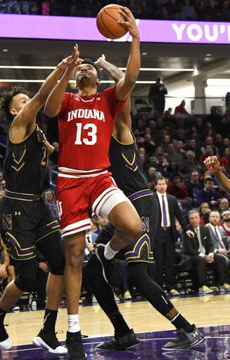 Indiana forward Juwan Morgan (13) goes to the basket as Northwestern forward A.J. Turner, left, defends him during the first half of an NCAA college basketball game Tuesday, Jan. 22, 2019, in Evanston, Ill.
