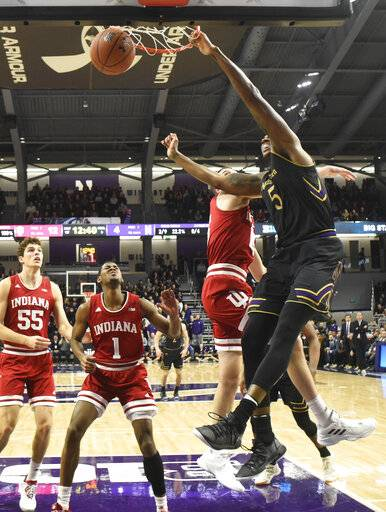 Northwestern center Dererk Pardon (5) dunks the ball against the Indiana during the first half of an NCAA college basketball game Tuesday, Jan. 22, 2019, in Evanston, Ill.