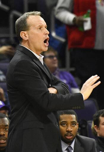 Northwestern head coach Chris Collins gestures to his team during the first half of an NCAA college basketball game Tuesday, Jan. 22, 2019, in Evanston, Ill.