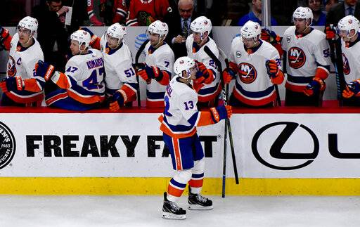 New York Islanders center Mathew Barzal (13) celebrates with teammates after scoring a goal against the Chicago Blackhawks during the second period of an NHL hockey game on Tuesday Jan. 22, 2019, in Chicago.