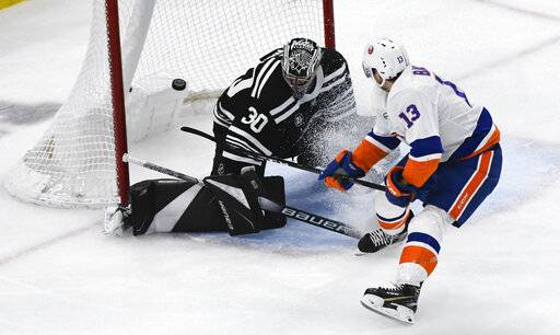New York Islanders center Mathew Barzal (13) scores a gaol past Chicago Blackhawks goaltender Cam Ward (30) during the second period of an NHL hockey game on Tuesday Jan. 22, 2019, in Chicago.
