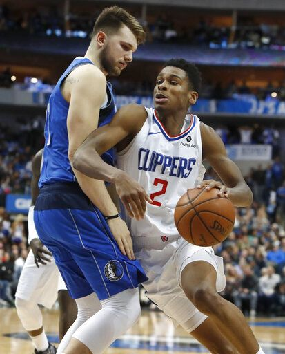 5e483639fe0e LA Clippers guard Shai Gilgeous-Alexander (2) drives against Dallas  Mavericks forward Luka