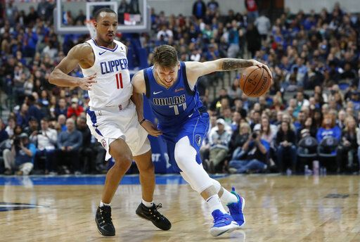 Dallas Mavericks forward Luka Doncic (77) of Germany drives against LA Clippers guard Avery Bradley (11) during the second half of an NBA basketball game in Dallas, Tuesday, Jan. 22, 2019. The Mavericks won 106-98.
