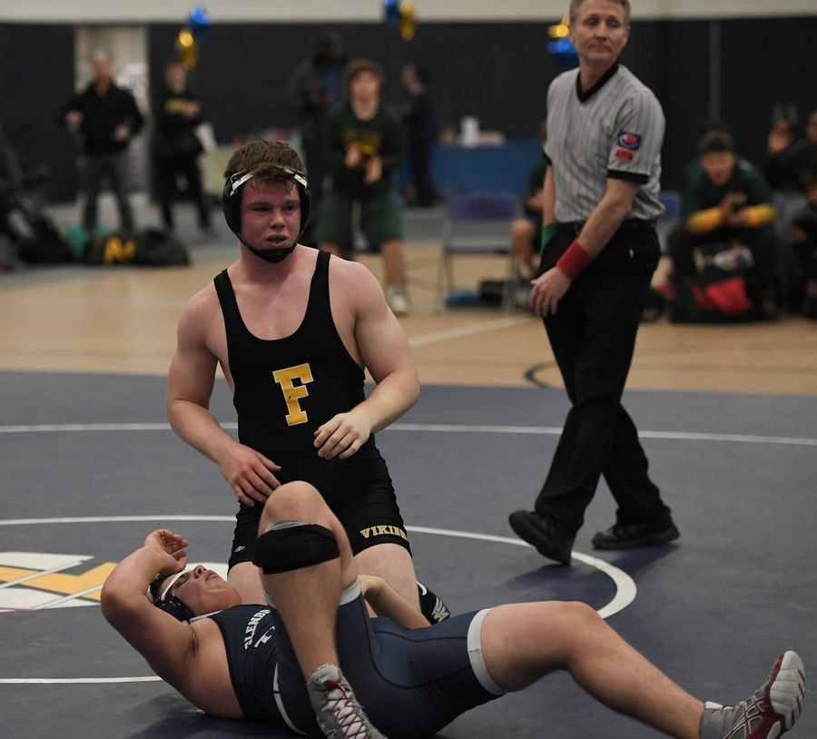 Fremd's Brian Morel looks up at the score after pinning Glenbrook South's Tudor Ursu to the mat for the win in the 220-pound weight class at Glenbrook South on Thursday.