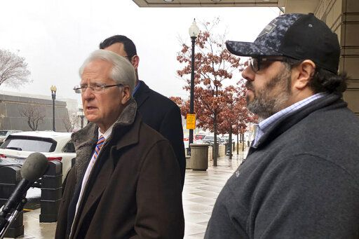 Attorney Larry Klayman, left, talks to the media, as Andrew Stettner, right, stepson of conservative writer Jerome Corsi, looks on, outside the federal courthouse after Stettner testified before a grand jury, Thursday, Jan. 24, 2019 in Washington.  Stettner was questioned for about an hour Thursday at the federal courthouse in Washington.