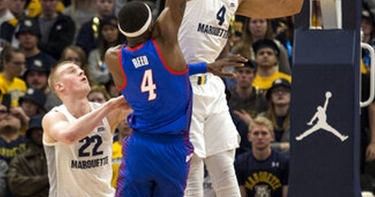 d96e8176b95 Howard scores 23 as No. 12 Marquette holds off DePaul 79-69