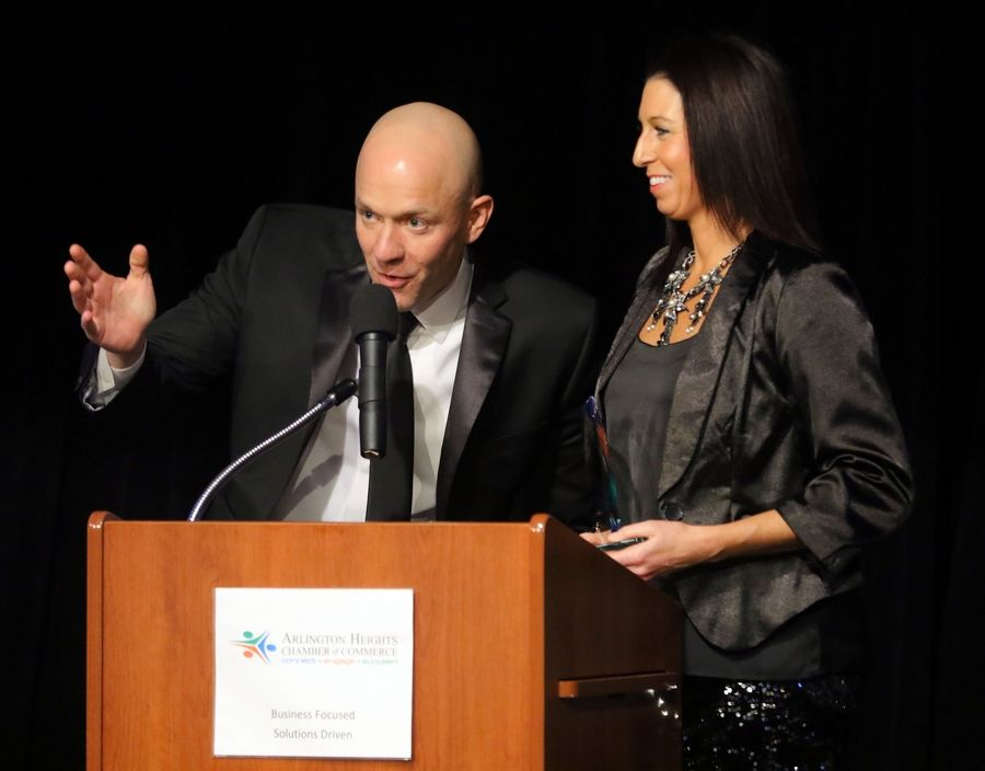 Jason and Ashley Miller of Fitness 19 accept the Business of the Year award during the Arlington Heights Chamber of Commerce's 72nd annual awards and recognition gala Friday at Arlington International Racecourse.