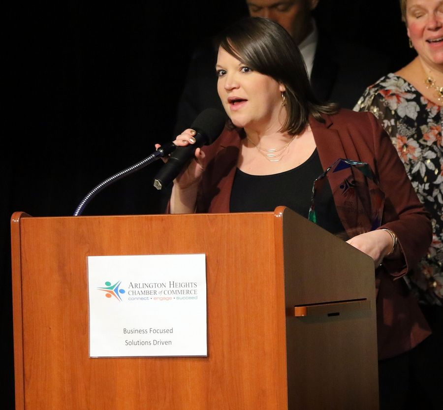 Nicole Espinoza of Arlington Cares says a few words after the group was awarded Nonprofit of the Year at the Arlington Heights Chamber of Commerce's 72nd annual awards and recognition gala Friday at Arlington International Racecourse.