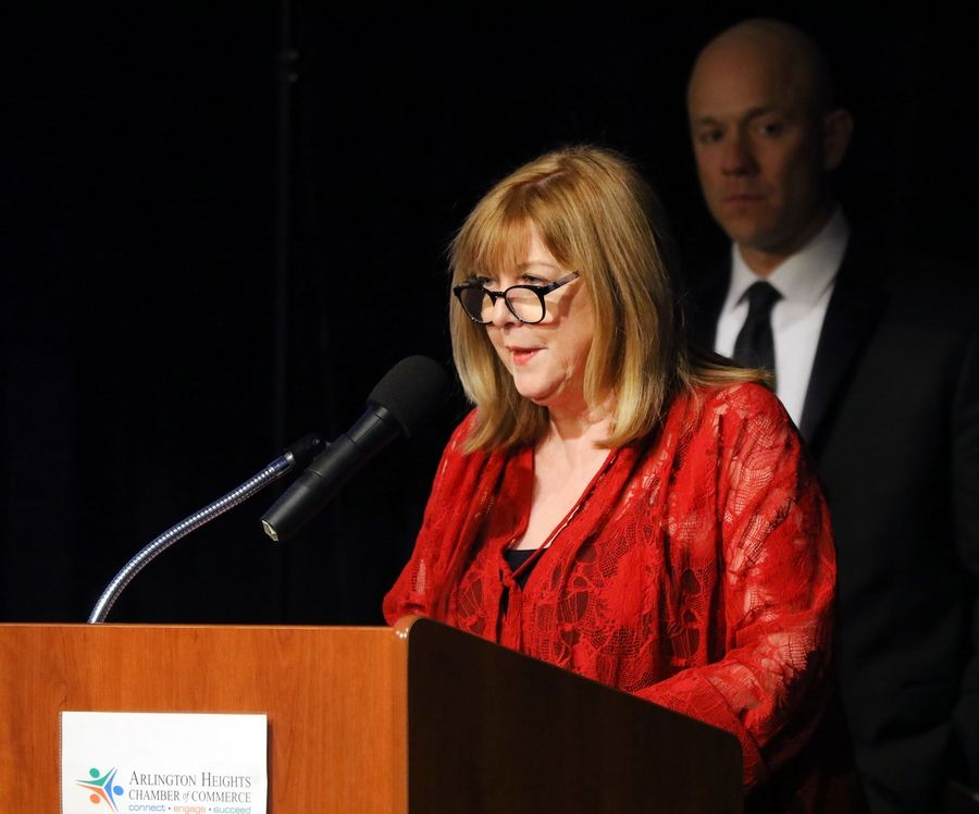 Mary Cay Chisholm of Northwest Speech and Hearing Center says a few words after winning the Business Leader of the Year award at the Arlington Heights Chamber of Commerce's 72nd annual awards and recognition gala Friday at Arlington International Racecourse.