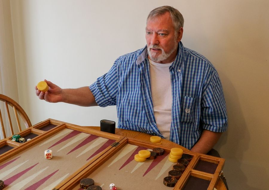 He didn't start playing backgammon until he was in his early 40s, but Tim Mabee, 72, of Naperville, is the longtime leader of one of the state's largest backgammon clubs.