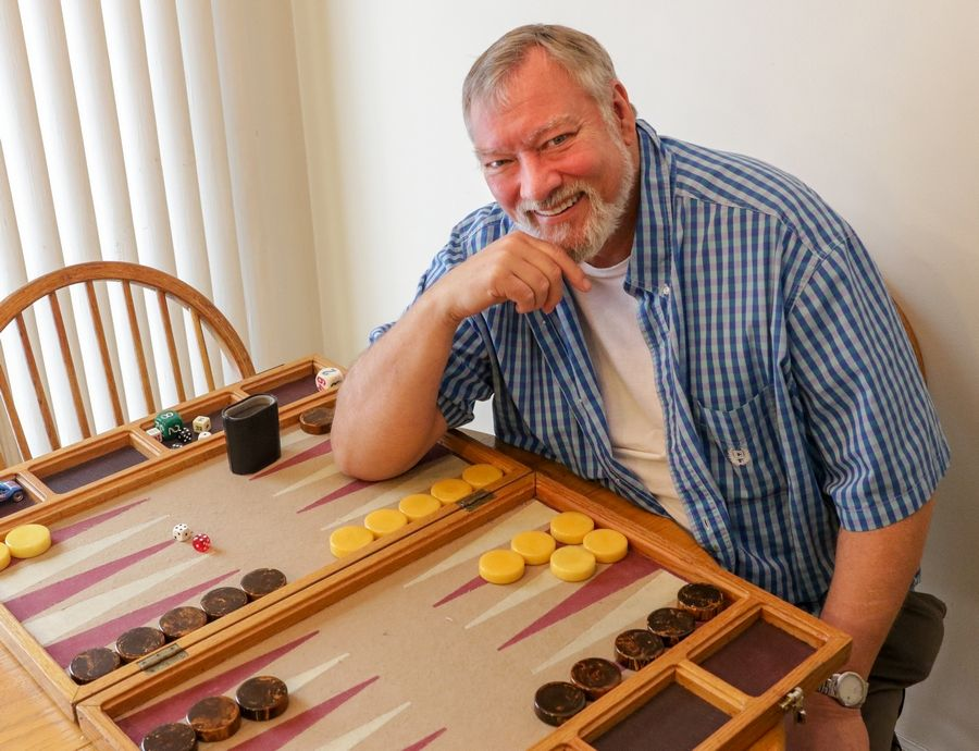 The beauty of backgammon is that dice add an element of chance, forcing players to have subtle strategies that always include a plan B, says Tim Mabee, 72, of Naperville. Mabee runs Pub Club, the most successful backgammon club in the state. More than two dozen players gather every Thursday night at Crazy Pour in Villa Park.