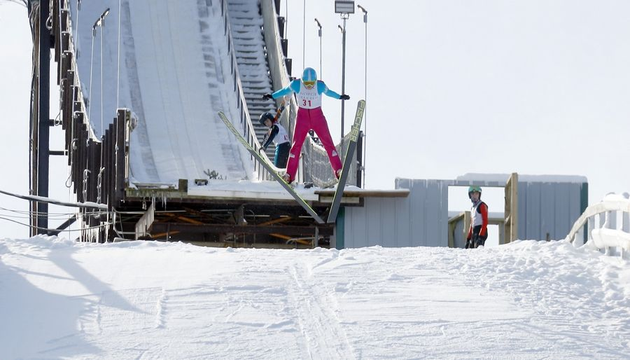 Sebastian Sproch of the Norge Ski Club lifts off from the large ski jump Sunday during the Norge Winter Ski Jump Tournament in Fox River Grove.