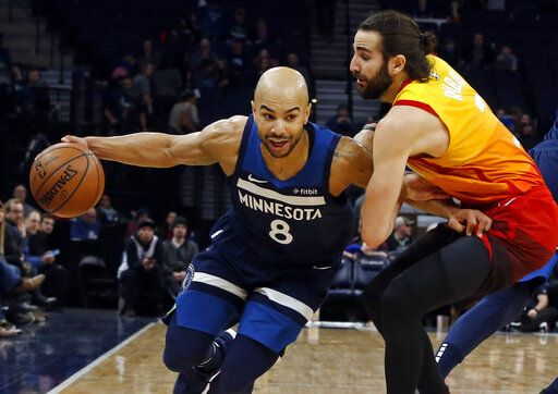 147eb02b Minnesota Timberwolves' Jerryd Bayless, left, gets tangled up with Utah  Jazz's Ricky Rubio