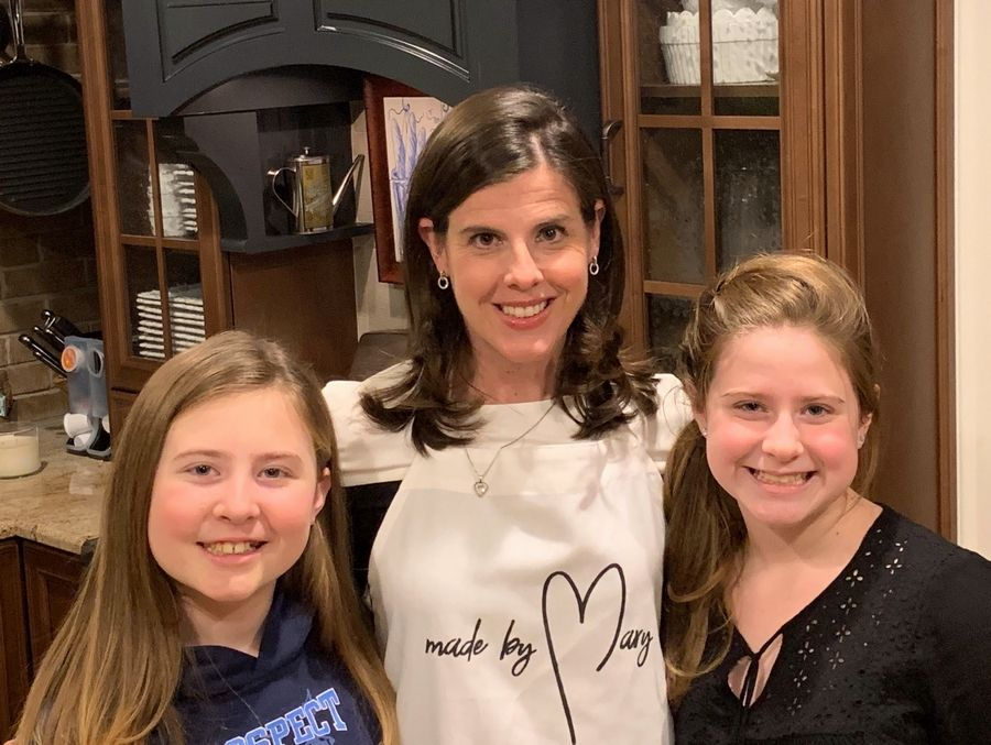 Erin Robinson and her daughters, Mary on the left and Kelly on the right, pause for a moment for a rare portrait shot of the three of them. Word of their mission to spread kindness and caring in the community, called Made by Mary, is growing.