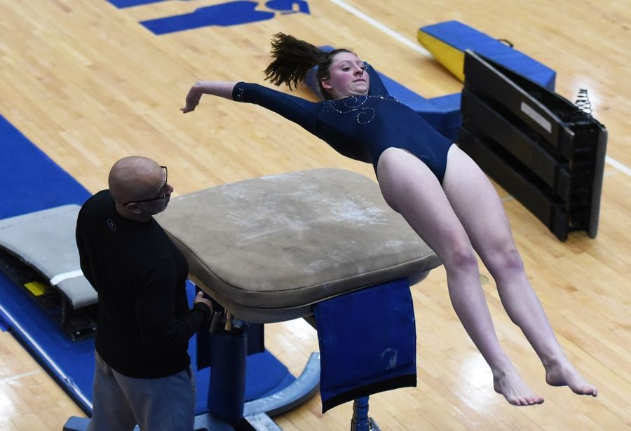 Fenton's Olivia Baran competes on the vault at Monday's regional girls gymnastics meet at Hoffman Estates High School.