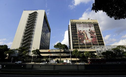 The headquarters of the state-owned oil company Petroleos de Venezuela, PDVSA, stands in Caracas, Venezuela, Monday, Jan. 28, 2019. The Trump administration imposed sanctions Monday on PDVSA, a potentially critical economic move aimed at increasing pressure on Venezuelan President Nicolas Maduro to cede power to the opposition.