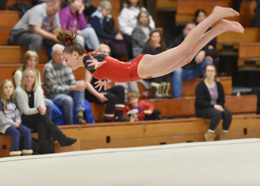 9af63f7dceac Bartlett's Allison Bucaro on the Floor Exercise at the Wheaton Warrenville  South Regional girls gymnastics meet