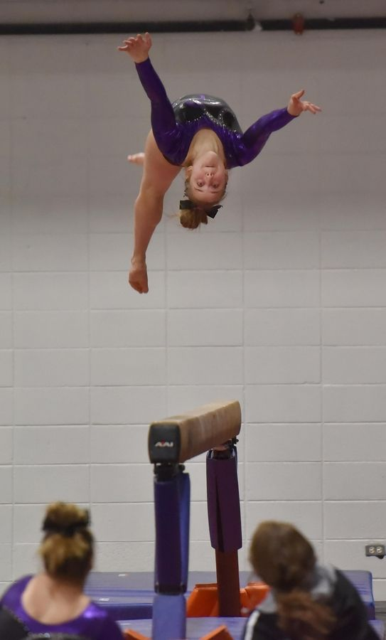 68623a1671c3 Wheaton's Jamie LaBue on the Beam at the Wheaton Warrenville South Regional  girls gymnastics meet Tuesday