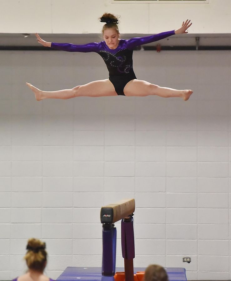 d2be64bcd03d Wheaton's Macy Smykal on the Beam at the Wheaton Warrenville South Regional  girls gymnastics meet Tuesday