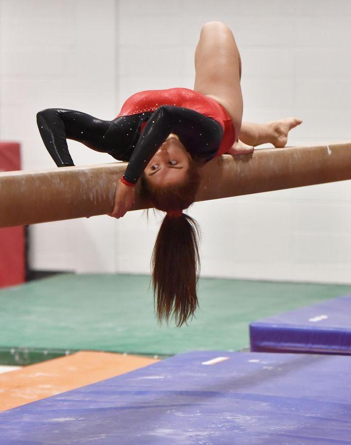 cc8443a8919d Bartlett's Kimberly Garcia on the Beam at the Wheaton Warrenville South  Regional girls gymnastics meet Tuesday