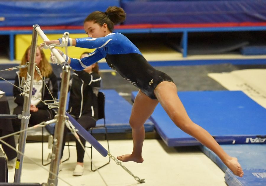 cf42b1c1662e Lake Park's Alyssa Mizzi on the Uneven Bars at the Wheaton Warrenville  South Regional girls gymnastics