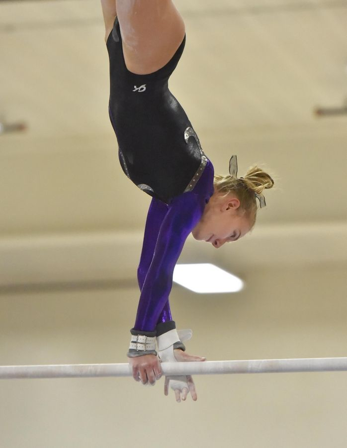01d1e0dcfaf0 Wheaton's Jackie Kerth on the Uneven Bars at the Wheaton Warrenville South  Regional girls gymnastics meet