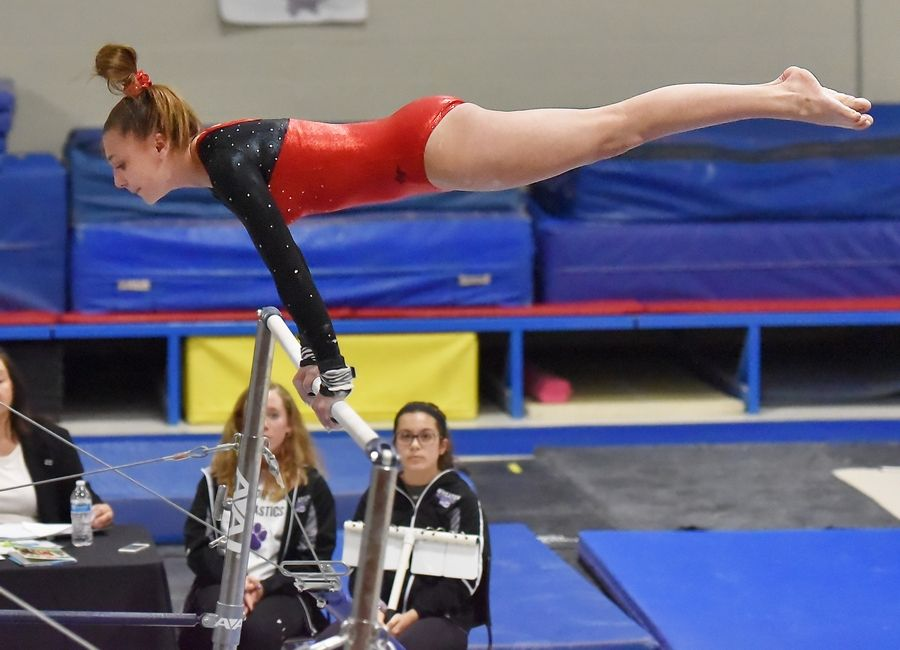 105e5c14ad39 Bartlett's Alison Bucaro on the Uneven Bars at the Wheaton Warrenville  South Regional girls gymnastics meet