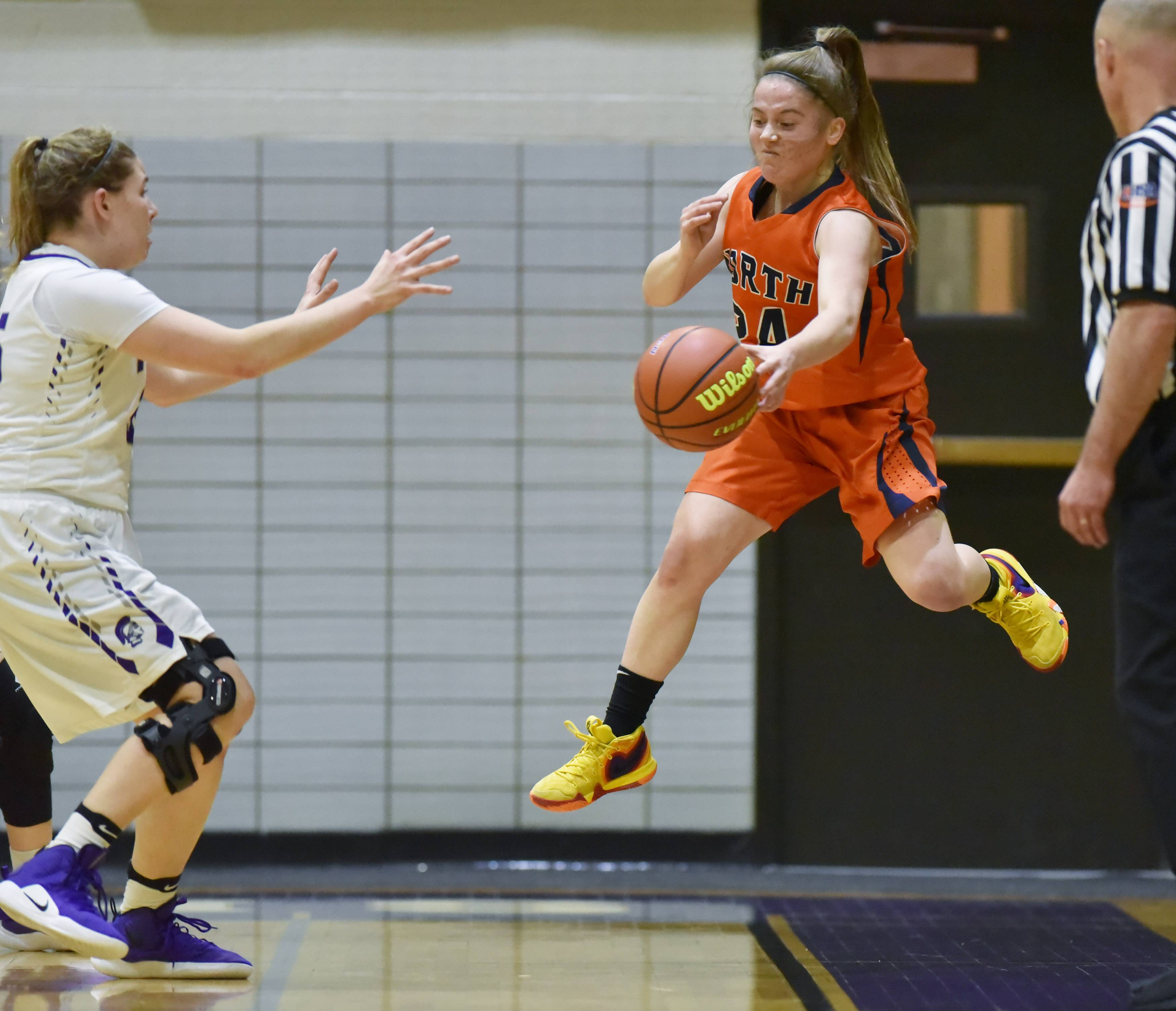 Naperville North's Kara Rivard saves the ball from going out of bounds against Downers Grove North in Downers Grove Wednesday.
