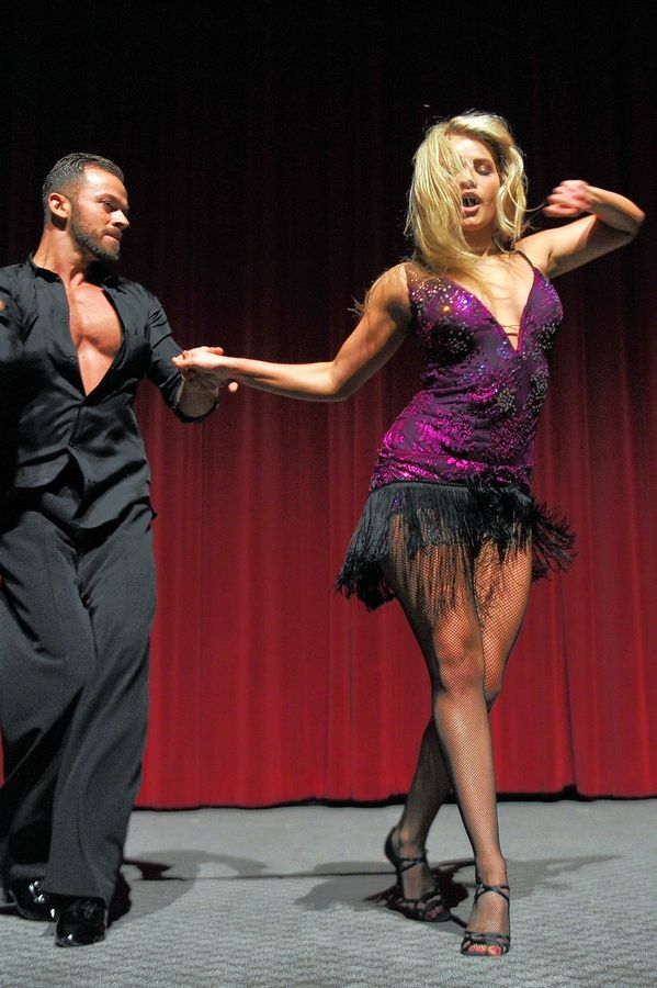"Dancers Artem Chigvintsev, left, and Witney Carson are featured in the tour of ""Dancing with the Stars Live: A Night to Remember"" at the Rosemont Theatre on Saturday, Feb. 2."