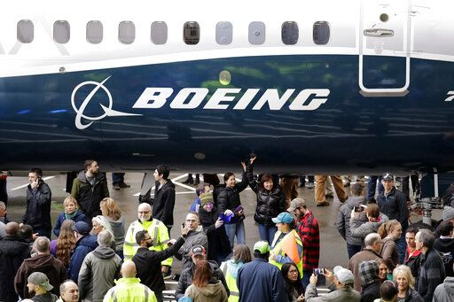 FILE- In this Feb. 5, 2018, file photo a Boeing 737 MAX 7, the newest version of Boeing's fastest-selling airplane, is displayed during a debut for employees and media of the new jet in Renton, Wash. The Boeing Company reports earnings Wednesday, Jan. 30, 2019.