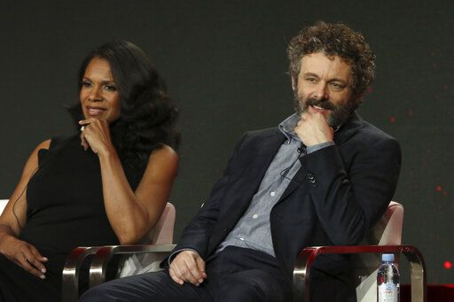"Audra McDonald, left, and Michael Sheen participate in the ""The Good Fight"" show panel during the CBS All Access presentation at the Television Critics Association Winter Press Tour at The Langham Huntington on Wednesday, Jan. 30, 2019, in Pasadena, Calif. (Photo by Willy Sanjuan/Invision/AP)"