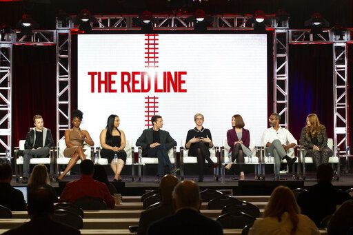 "Noel Fisher, from left, Emayatzy Corinealdi, Aliyah Royale, Noah Wyle, Caitlin Parrish, Erica Weiss, Sunil Nayar and Sarah Schechter participates in the ""The Red Line"" show panel during the CBS presentation at the Television Critics Association Winter Press Tour at The Langham Huntington on Wednesday, Jan. 30, 2019, in Pasadena, Calif. (Photo by Willy Sanjuan/Invision/AP)"