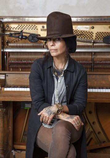 In this Jan. 23, 2019 photo, Linda Perry poses for a portrait at her studio in Los Angeles. Perry, one of the most respected producers in music industry, earned her first-ever Grammy nomination for non-classical producer of the year, becoming the ninth female to earn a nomination in the category in the organization's 61-year history, and the first women nominated for the prize in 15 years. (Photo by Rebecca Cabage/Invision/AP)