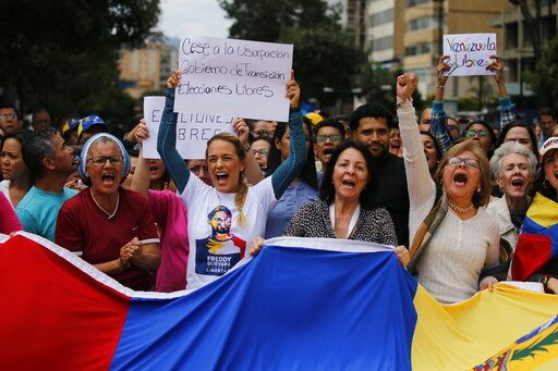 "Lilian Tintori, the wife of jailed opposition leader Leopoldo Lopez, center left, chants ""Free elections"" in a walk out against President Nicolas Maduro, in Caracas, Venezuela, Wednesday, Jan. 30, 2019. Venezuelans are exiting their homes and workplaces in a walkout organized by the opposition to demand that Maduro leave power."