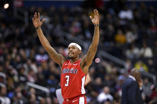 Washington Wizards guard Bradley Beal reacts to a score by a teammate during the second half of an NBA basketball game against the Indiana Pacers, Wednesday, Jan. 30, 2019, in Washington. The Wizards won 107-89.