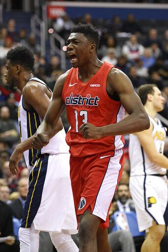 Washington Wizards center Thomas Bryant (13) reacts during the first half of an NBA basketball game against the Indiana Pacers, Wednesday, Jan. 30, 2019, in Washington.