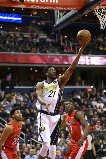 Indiana Pacers forward Thaddeus Young (21) goes to the basket against Washington Wizards forward Otto Porter Jr. (22) and center Thomas Bryant (13) during the second half of an NBA basketball game, Wednesday, Jan. 30, 2019, in Washington. The Wizards won 107-89.